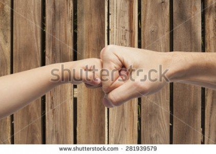 stock-photo-father-and-son-punching-fists-hands-for-agreement-over-a-wooden-background-281939579